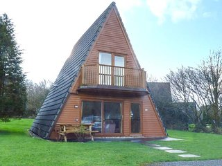 22 WATERSIDE CORNWALL, detached lodge with balcony, on-site swimming pool and