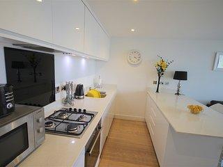 Kitchen with dishwasher, fridge and freezer. .Washer Dryer separate