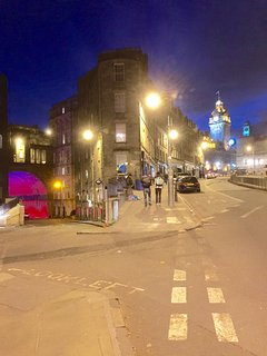 Evening view towards the apartment building and the east end of Princes Street.