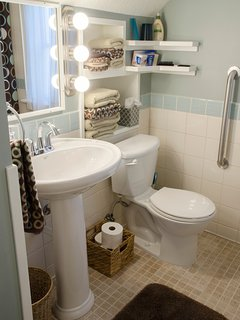 The upstairs bath is well-stocked with all your toiletry needs—and the makeup mirror has no rivals!