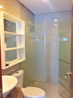 Bathroom also has glass shower enclosures