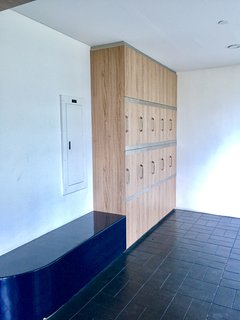 Locker area with seating area right beside the gym