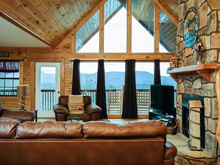 Open floor  where you can enjoy 55'smart tv or view the wall of glass  with beautiful mts views