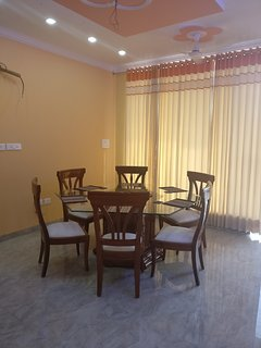 Lobby with 6 chairs dining table.