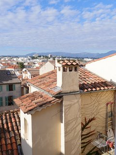 Overview on Antibes's old town roofs and mountains.
