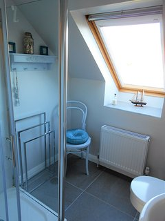 Upstairs Bathroom with Electric Shower, Wash Basin and WC.