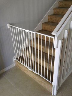 Safety gate fitted at bottom of stairs