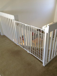 Upstairs child safety gate. Gates are fitted to both top and bottom of the stairs.