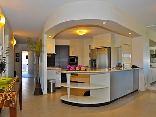 Large modern kitchen complete with appliances