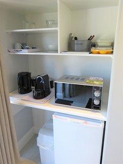Amenities: coffee machine, tea, microwave, small fridge.