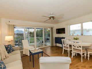 Canal Front Beach Chic Cottage w/Boat Dock - Walk to Tin City/Bay Front/5th Ave.