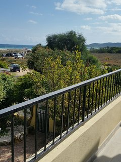 Spacious open-air balcony, with a view to the beach in front of the accommodation. The beach in fron