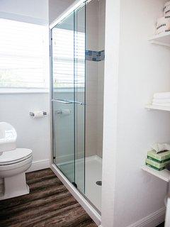 Bathroom with walk-in shower pool-side