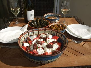 Enjoy Lunch - Greek salad, houmous, vine leaves & olives with a nice cold glass of local wine