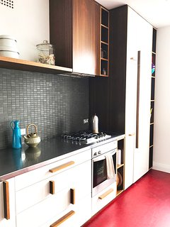 kitchen with fully integrated laundry - washer and dryer