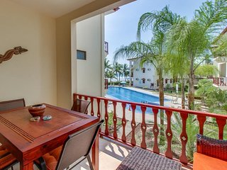 Condo in oceanfront resort offers easy access to beach, shared pool, and more!