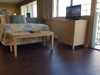 Condo has living area w/ foldout couch, LCD TV,kitchenette, balcony w/ seating, Honolulu