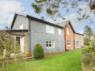 HOLLY FARM COTTAGE, multi-fuel stove, lawned garden with patio, fantastic walks