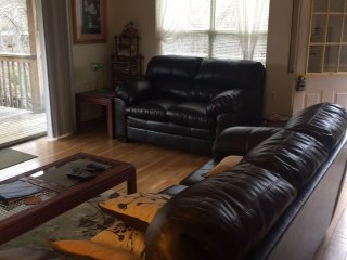 new leather loveseat added, for cozy lounging!