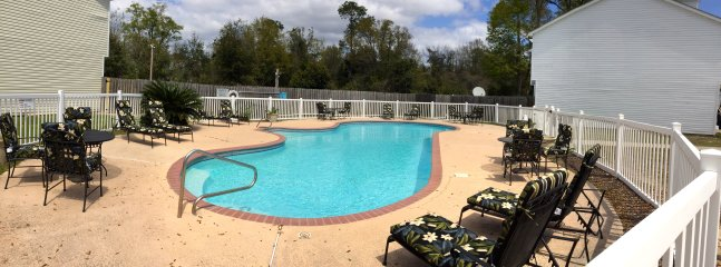 Clean swimming pool heated naturally by the sun.  Right next to our townhouse