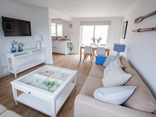 Beachstyle tasteful open plan detached home, near beach and village. Sea views.