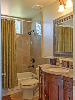 This bathroom features a vanity sink and shower/tub.