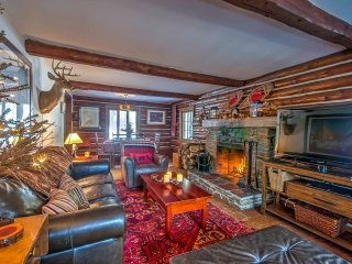 Warm your feet by the stone fireplace while watching a show on the TV in the cozy living area.