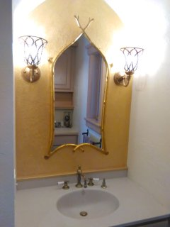 The Castle Cottage bathroom mirror over sink.