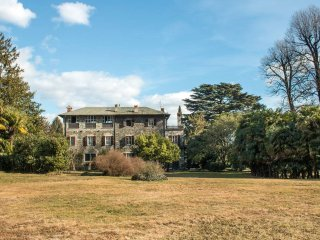 Surrounded by a pristine garden stands the Casetta nel Parco., Dongo