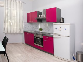 Pavelin apartments 2.Bedroom with 2 beds.Bathroom with shower.Kitchen and dining