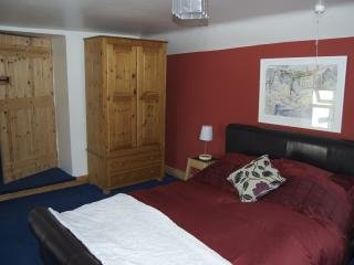 Bedroom 2 with double bed & cot. Sea views