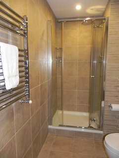 The en-suite bathroom has a fabulous drench shower