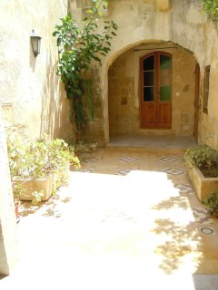 ZNUBER holiday house ground floor patio with door leading to triple bedroom
