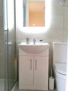 En-suite Shower Room with large Shower, rainwater and hand shower, wash hand basin and toilet