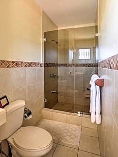 This bathroom features a spacious vanity and large walk-in shower.