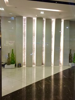 Entrance lobby with wall design and cove lighting