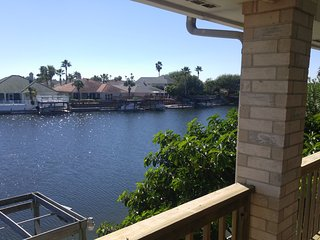 Top Level Canal Water Front Home!