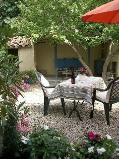 Private rear patio with seating