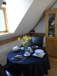 The dining area with fresh flowers on arrival.
