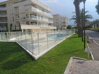 Apartment on the beach with private swimming pool . Secure private parking.