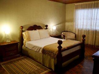 Queen bed accomodates 2 people