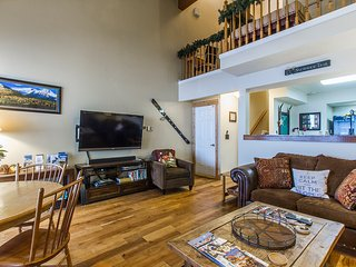 View with loft above, 60' HDTV w/DVD Blu Ray player. Rustic elegance decor throughout condo