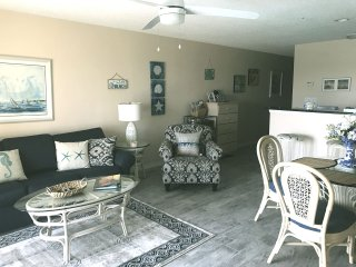 Living area. New wood-look tiles throughout the condo