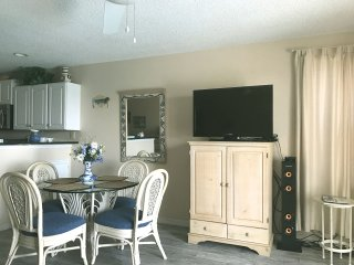 Dining area, TV, DVD player and sound tower with Bluetooth connectivity