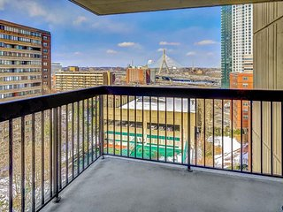 Spacious condo with private balcony, city views, and shared pool access!