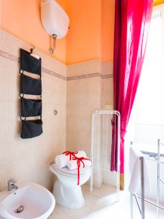 Bathroom with large window overlooking the garden, complete with all the soaps for shower, hairdryer
