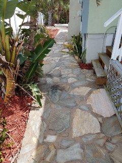 Path from pool courtyard to front yard and front door
