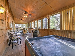 The wraparound screened porch features a private hot tub.
