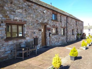 BRAMBLE HARE COTTAGE, mid-terrace, great views, woodburning stove near Ireby