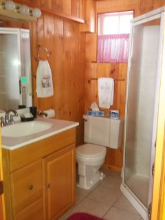 Full Bath With timed overhead heater and towel warmer.